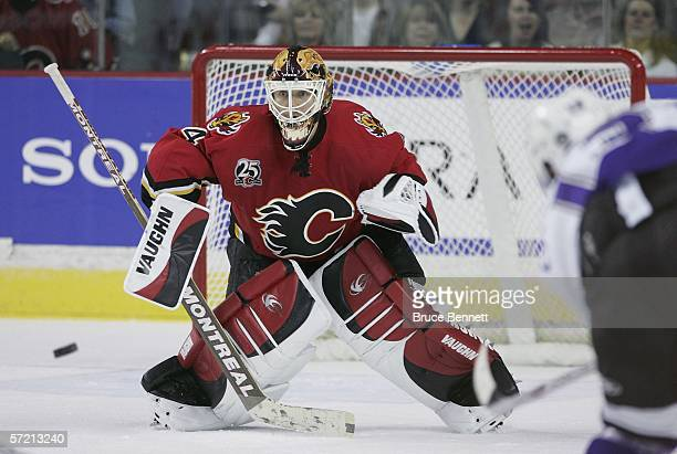 Miikka Kiprusoff of the Calgary Flames follows a shot from the Los Angeles Kings on March 29 2006 at the Pengrowth Saddledome in Calgary Alberta...