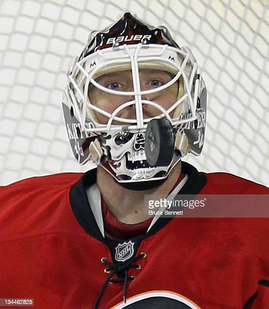 Miikka Kiprusoff of the Calgary Flames keeps his eye on the puck during third period action against the Columbus Blue Jackets at the Scotiabank...