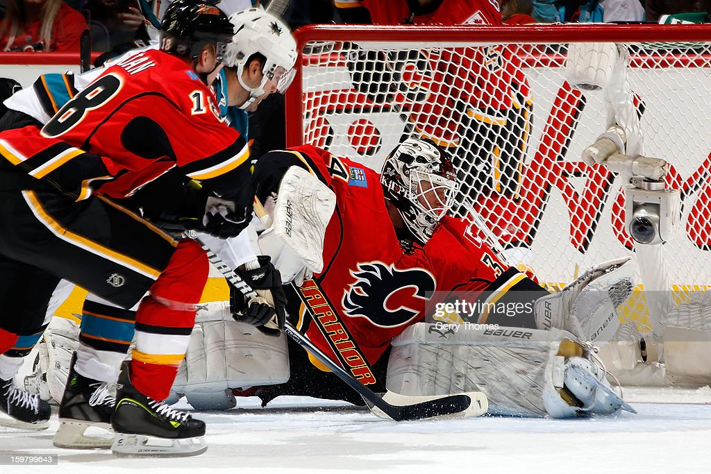 Miikka Kiprusoff #34 of the Calgary Flames makes a glove save against the San Jose Sharks on January 20, 2013 at the Scotiabank Saddledome in Calgary, Alberta, Canada.