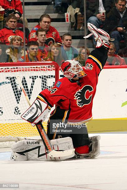 Miikka Kiprusoff of the Calgary Flames makes a glove save against the New York Islanders on January 8, 2009 at Pengrowth Saddledome in Calgary,...
