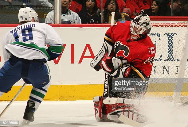 Miikka Kiprusoff of the Calgary Flames makes a save against Markus Naslund of the Vancouver Canucks on March 25 2008 at Pengrowth Saddledome in...