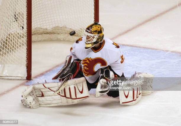 Miikka Kiprusoff of the Calgary Flames makes a save against the San Jose Sharks in Game five of the 2004 NHL Western Conference Finals during the...