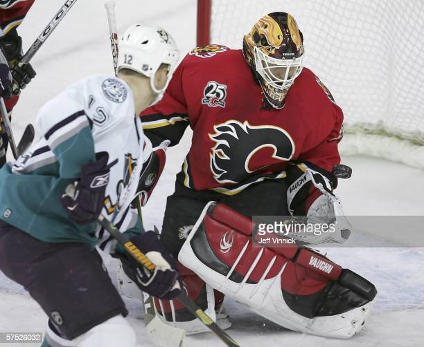 Miikka Kiprusoff of the Calgary Flames makes a save off the shot of Jeff Friesen of the Anaheim Mighty Ducks in the first period of game seven of the...