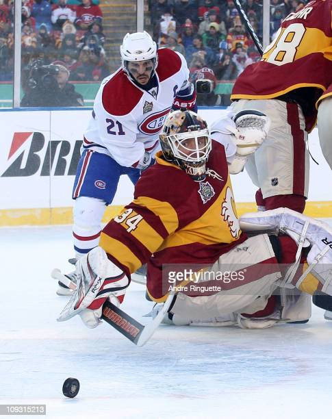 Miikka Kiprusoff of the Calgary Flames makes the save as Brian Gionta of the Montreal Canadiens looks for a rebound during the 2011 NHL Heritage...