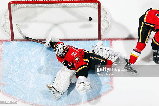 Miikka Kiprusoff of the Calgary Flames misses a save against the Nashville Predators on October 22 2011 at the Scotiabank Saddledome in Calgary...