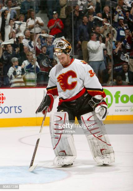 Miikka Kiprusoff of the Calgary Flames skates back to his crease during the game against the Vancouver Canucks in the first round of the 2004 NHL...