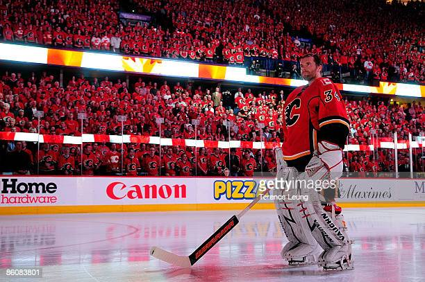 Miikka Kiprusoff of the Calgary Flames stands for the national anthem ceremonies amidst Calgary's C of Red against the Chicago Blackhawks during Game...