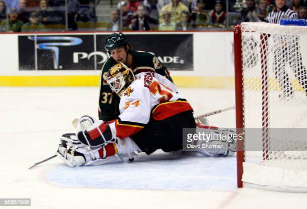 Miikka Kiprusoff of the Calgary Flames stop the shot by Wes Walz of the Minnesota Wild during their season opening game on October 5, 2005 at the...