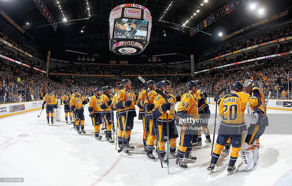 Miikka Salomaki #20 congratulates Pekka Rinne #35 of the Nashville Predators on a shutout win against the Boston Bruins during an NHL game at Bridgestone Arena on February 18, 2016 in Nashville, Tennessee.