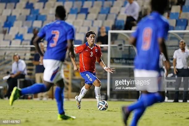 Miiko Albornoz of Chile brings the ball up field against Haiti during an International Soccer friendly match on September 9, 2014 at Lockhart Stadium...