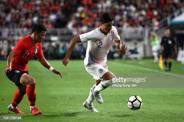 Miiko Albornoz of chile competes foe the ball with Hwang Hee-Chan of South Korea during the International friendly match between South Korea and...