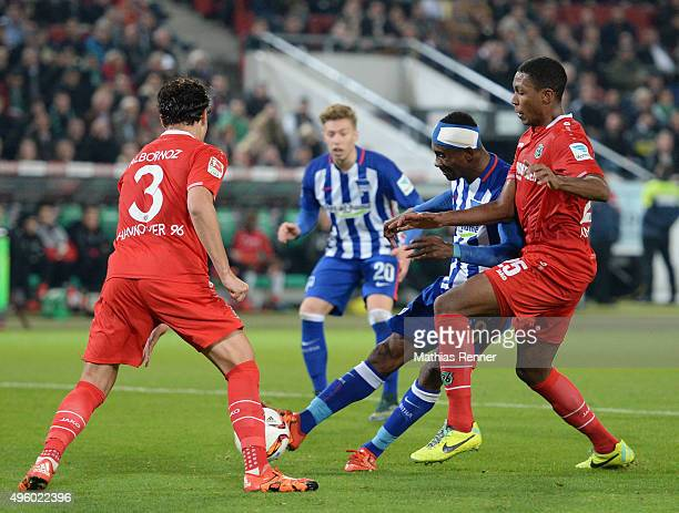 Miiko Albornoz of Hannover 96 Salomon Kalou of Hertha BSC and Marcelo of Hannover 96 during the Bundesliga match between Hannover 96 and Hertha BSC...