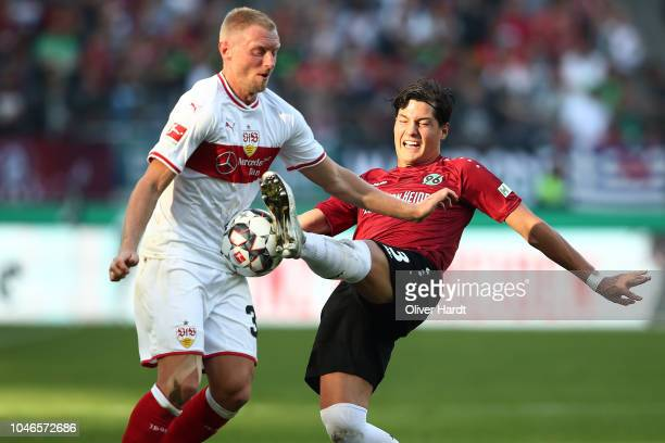 Miiko Albornoz of Hannover and Andreas Beck of Stuttgart compete for the ball during the Bundesliga match between Hannover 96 and VfB Stuttgart at...