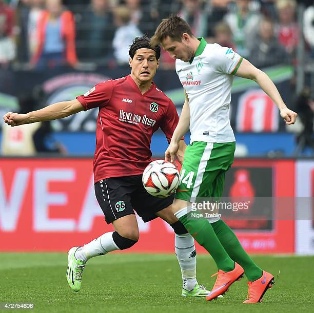 Miiko Albornoz of Hannover is challenged by Izet Hajrovic of Bremen during the Bundesliga match between Hannover 96 and SV Werder Bremen at HDI-Arena...