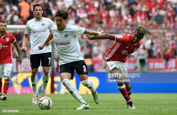 Miiko Albornoz of Hannover is challenged by Kingsley Coman of Muenchen during the Bundesliga match between FC Bayern Muenchen and Hannover 96 at...