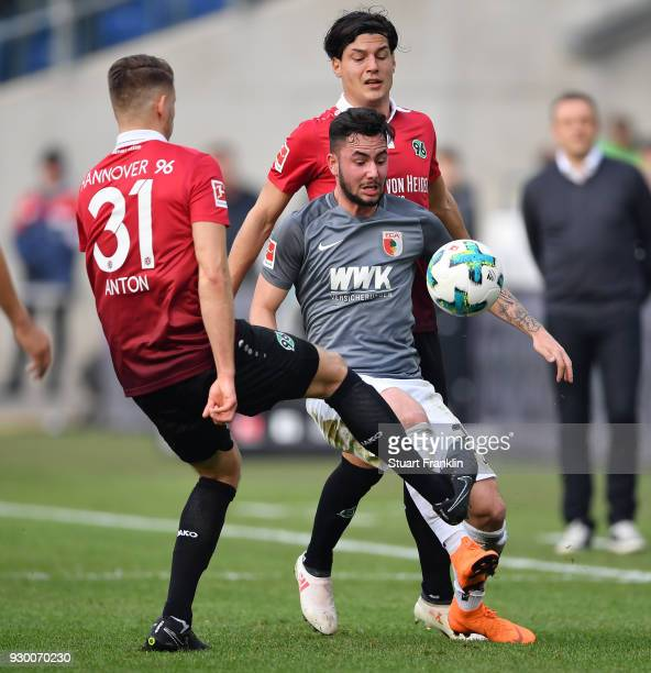 Miiko Albornoz of Hannover is challenged by Marco Richter of Augsburg during the Bundesliga match between Hannover 96 and FC Augsburg at HDIArena on...