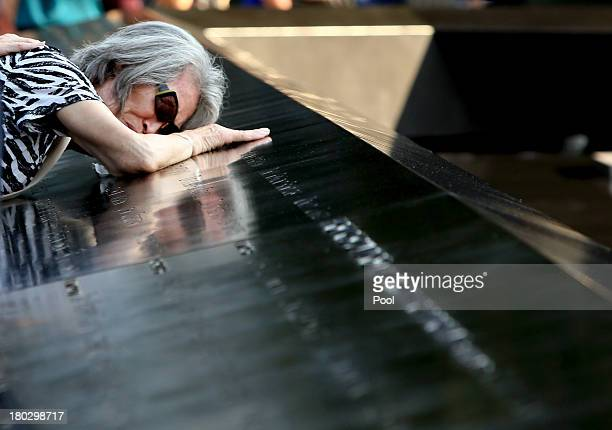 Mija Quigley of Princeton Junction NJ embraces the name of her son Patrick Quigley who died aboard Flight 175 during ceremonies for the twelfth...