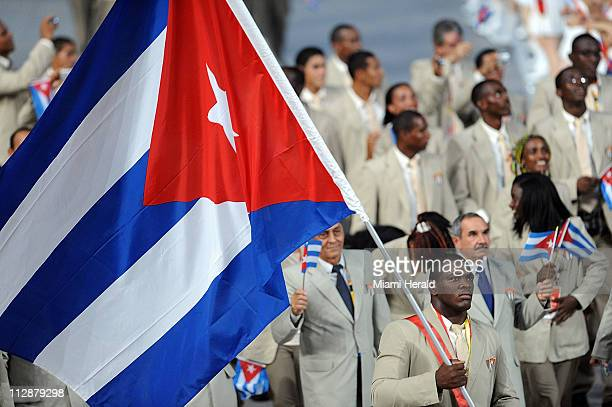 Mijain Lopez carries the flag for Cuba in the National Stadium during the opening ceremony on Friday August 8 to kick off the Games of the XXIX...