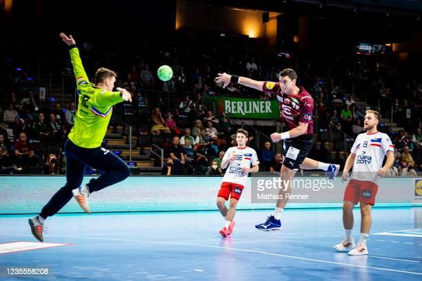Mijajlo Marsenic of Fuechse Berlin and Mateusz Zembrzycki of KS Azoty-Pulawy during the EHF Handball European League match between Fuechse Berlin and...