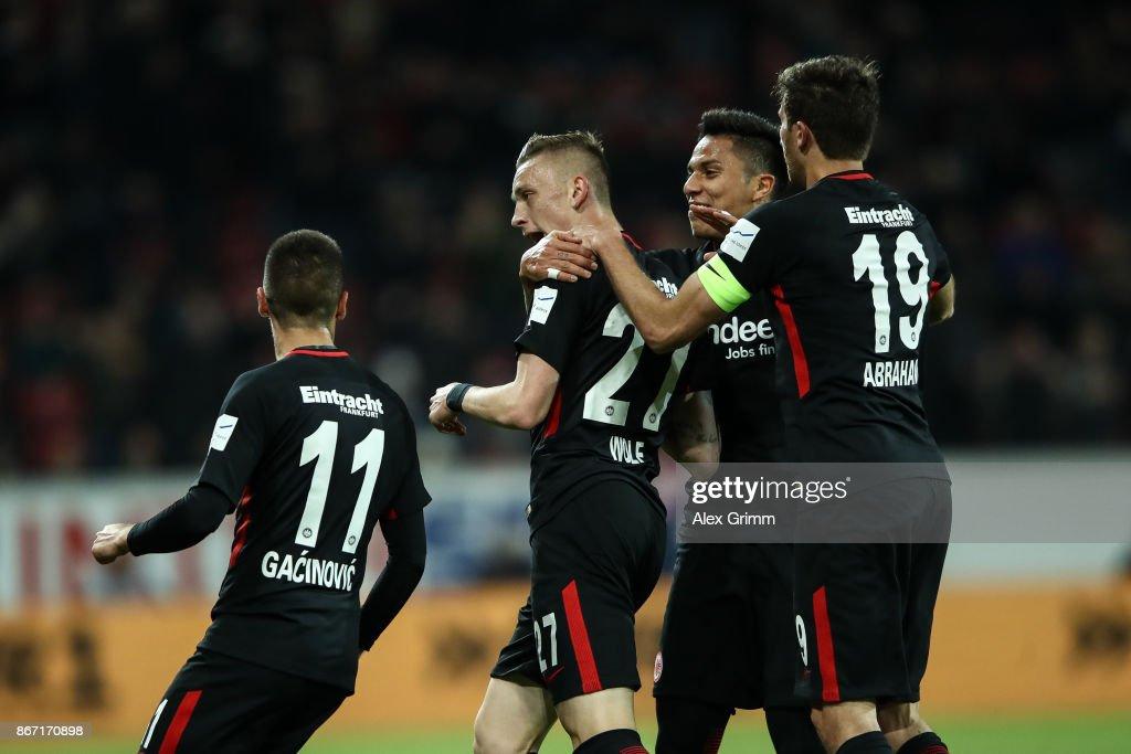 Mijat Gacinovic #11, Kenan Kodro (R) and Marius Wolf #27 of Frankfurt celebrate after 0-1 during the Bundesliga match between 1. FSV Mainz 05 and Eintracht Frankfurt at Opel Arena on October 27, 2017 in Mainz, Germany.