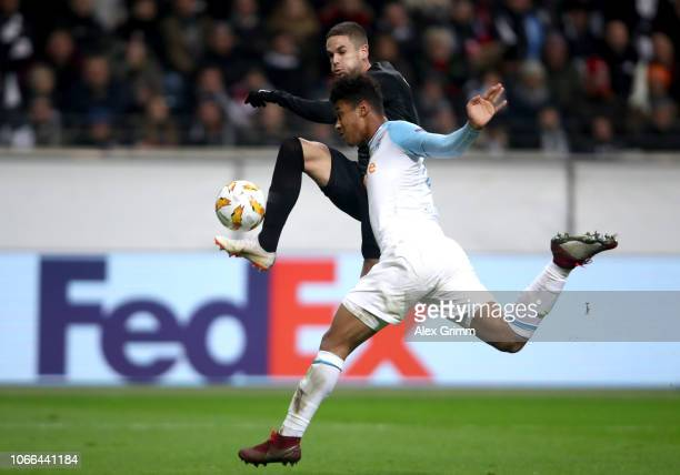 Mijat Gacinovic of Eintracht Frankfurt is challenged by Boubacar Kamara of Marseille during the UEFA Europa League Group H match between Eintracht...