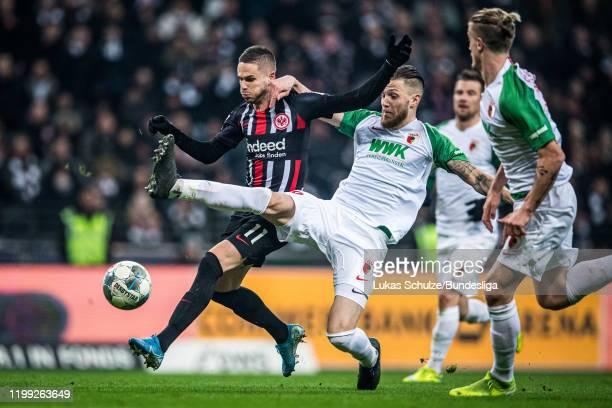 Mijat Gacinovic of Frankfurt and Jeffrey Gouweleeuw of Augsburg in action during the Bundesliga match between Eintracht Frankfurt and FC Augsburg at...