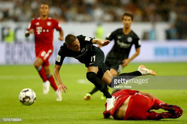 Mijat Gacinovic of Frankfurt and Mats Hummels of Muenchen battle for the ball during the DFL Supercup 2018 between Eintracht Frankfurt and Bayern...