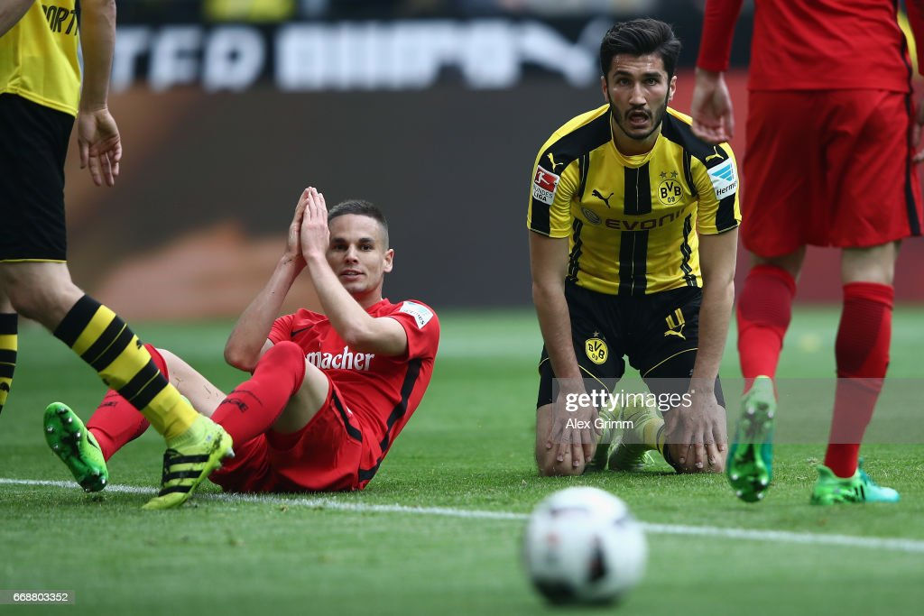Mijat Gacinovic (L) of Frankfurt and Nuri Sahin of Dortmund react during the Bundesliga match between Borussia Dortmund and Eintracht Frankfurt at Signal Iduna Park on April 15, 2017 in Dortmund, Germany.