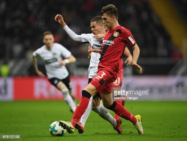 Mijat Gacinovic of Frankfurt and Panagiotis Retsos of Leverkusen compete for the ball during the Bundesliga match between Eintracht Frankfurt and...