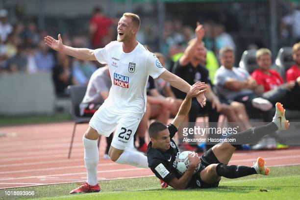 Mijat Gacinovic of Frankfurt battles for the ball with Steffen Kienle of Ulm during the DFB Cup first round match between SSV Ulm 1846 Fussball v...