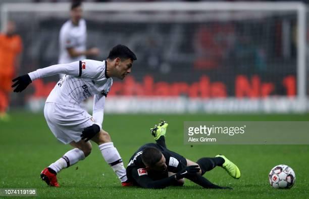 Mijat Gacinovic of Frankfurt challenges of Charles Aranguiz Leverkusen during the Bundesliga match between Eintracht Frankfurt and Bayer 04...