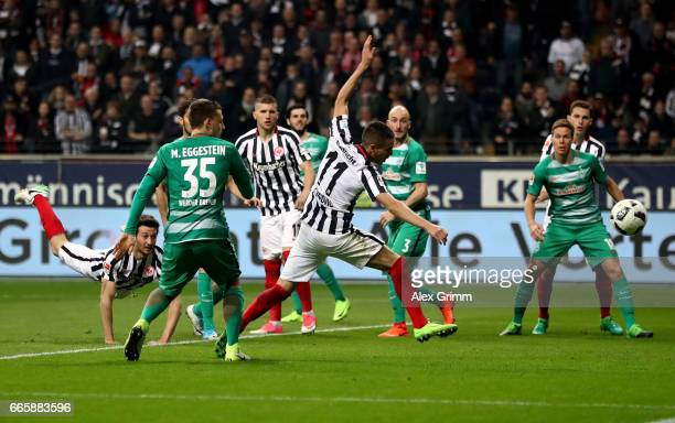 Mijat Gacinovic of Frankfurt heads his team's 1st goal during the Bundesliga match between Eintracht Frankfurt and Werder Bremen at CommerzbankArena...