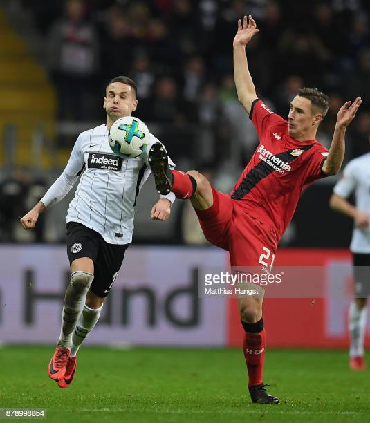 Mijat Gacinovic of Frankfurt is challenged by Dominik Kohr of Leverkusen during the Bundesliga match between Eintracht Frankfurt and Bayer 04...