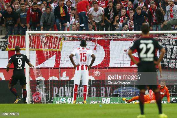 Mijat Gacinovic of Frankfurt scores his teams first goal form the penalty spot past goalkeeper Timo Horn of Koeln to make it 1:0 during the...