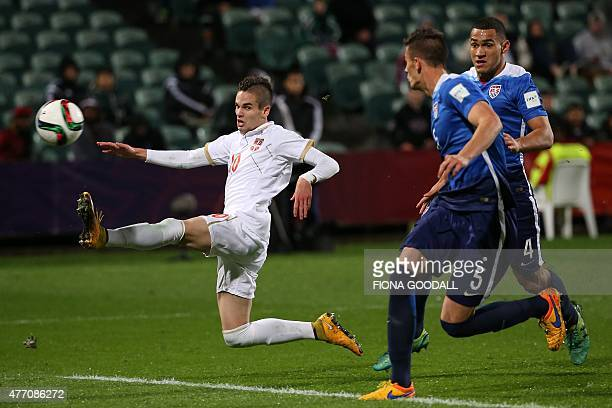 Mijat Gacinovic of Serbia takes a shot at goal as Cameron CarterVickers and Matthew Miazga defend during the FIFA U20 World Cup quarterfinal match...