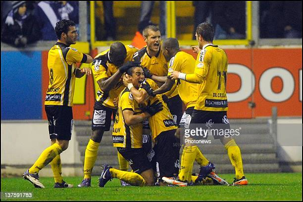 Mijat Maric of Sporting Lokeren OVL celebrates scoring a goal with his teammates during the Cofidis Cup quarter-final match between KAA Gent and...
