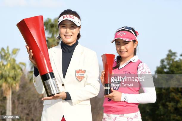 MiJeong Jeon of South Korea and Yui Kawamoto of Japan pose with the trophy during award ceremony for the Yokohama Tire PRGR Ladies Cup at the Tosa...