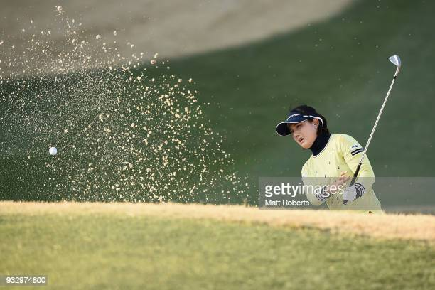MiJeong Jeon of South Korea hits out of the 18th green bunker during the second round of the TPoint Ladies Golf Tournament at the Ibaraki Kokusai...
