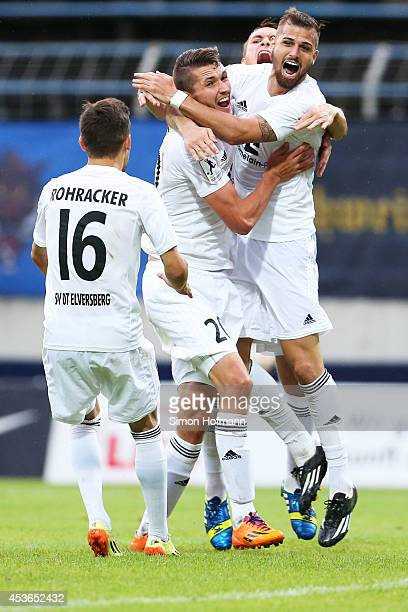 Mijo Tunjic of Elversberg celebrates his team's second goal with his team mates during the Regionalliga Suedwest match between 1. FC Saarbruecken and...