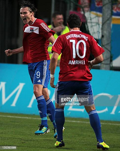 Mijo Tunjic of Unterhaching celebrates with team mate Patrick Amrhein after scoring his team's first goal during the Third League match between SpVgg...