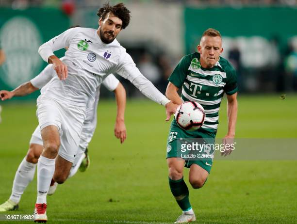 Mijusko Bojovic of Ujpest FC fights for the ball with Ivan Petryak of Ferencvarosi TC during the Hungarian OTP Bank Liga match between Ferencvarosi...