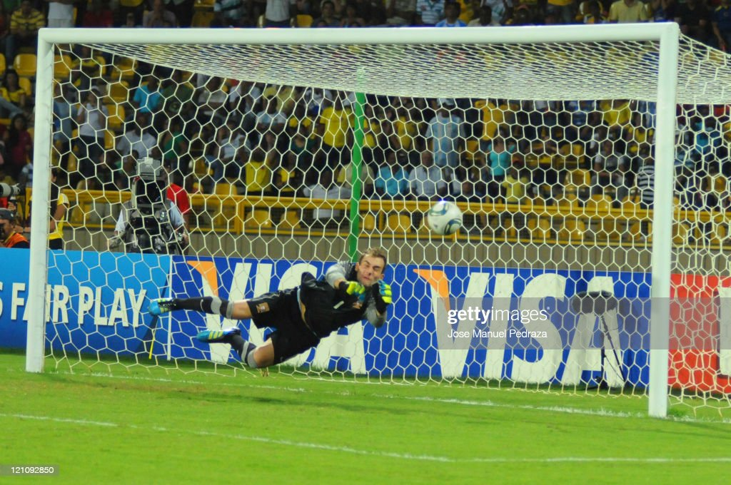 Mika, from Portugal stops the third penalty in the penalty shoot out the match between Argentina and Portugal as part of the U20 World Cup Colombia 2011 at Jaime Moron Stadium on August 13, 2011 in Cartagena, Colombia.