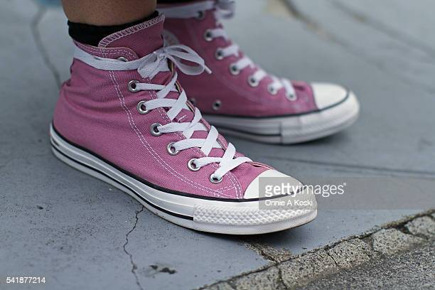 Mika Fukasawa is wearing a vintage dress Converse Chuck Taylor All Star pink shoes and has Tattoos by TFTD Tattoo Shop during a Street Style session...