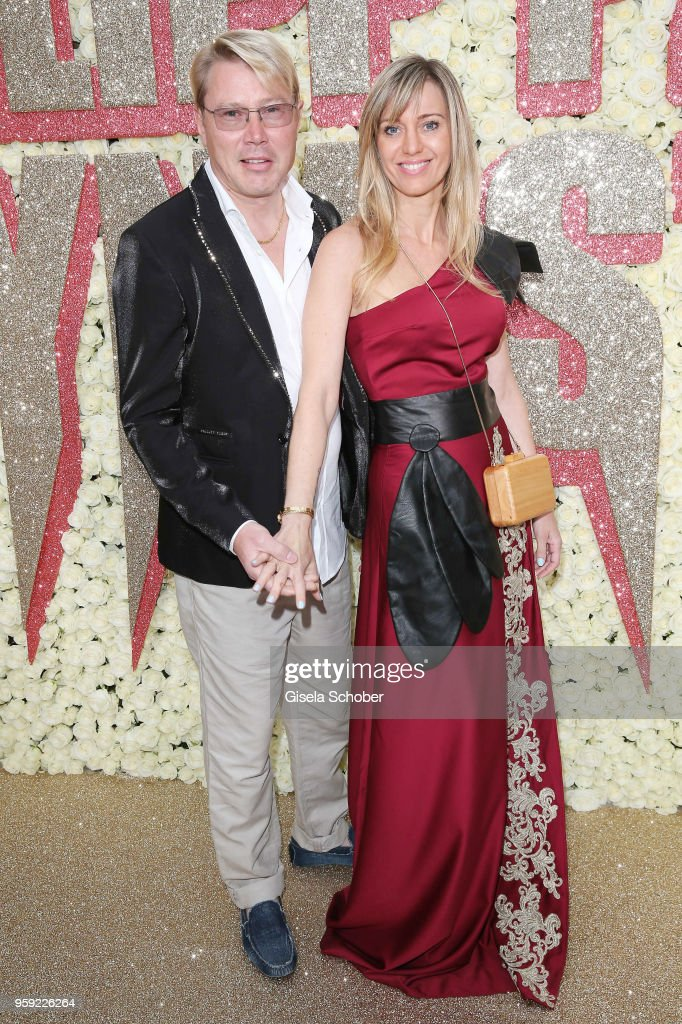Mika Hakkinen and Marketa Remesovan attend Philipp Plein 'Dynasty' Women's & Men's Resort 2019 Fashion Show during the 71st annual Cannes Film Festival at on May 16, 2018 in Cannes, France.