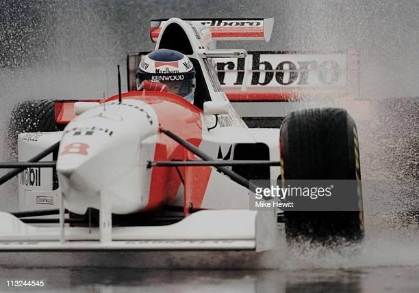 Mika Hakkinen drives the Marlboro McLaren Mercedes McLaren MP410 Mercedes 30 V10 through the rain puddles during practice for the Marlboro Grand Prix...