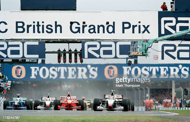 Mika Hakkinen drives the West McLaren Mercedes McLaren MP413 Mercedes 30 V10 ahead of the field at the start of the RAC British Grand Prix on 12th...