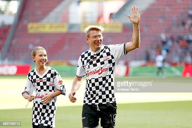 Mika Hakkinen greets the spectators during the 'Champions for charity' football match between Nowitzki All Stars and Nazionale Piloti in honor of...