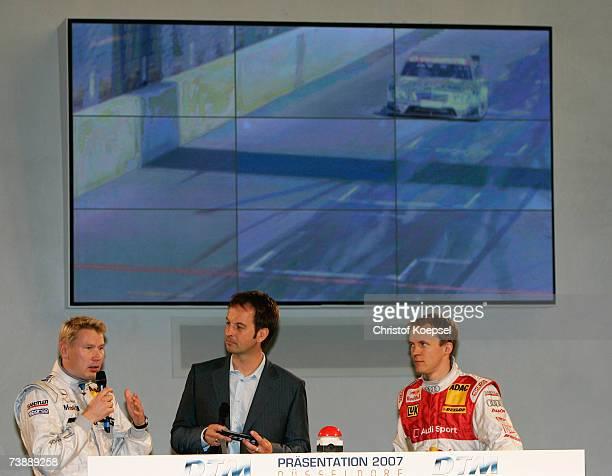 Mika Hakkinen of AMG Mercedes talks to moderator Claus Lufen and Mattias Eksstrom of Audi Sport Team Abt Sportsline during the German Touring Car...