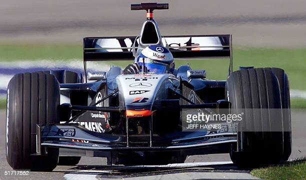 Mika Hakkinen of Findland takes his McLaren Mercedes through a turn during the practice session 29 September, 2001 at the US Grand Prix at the...