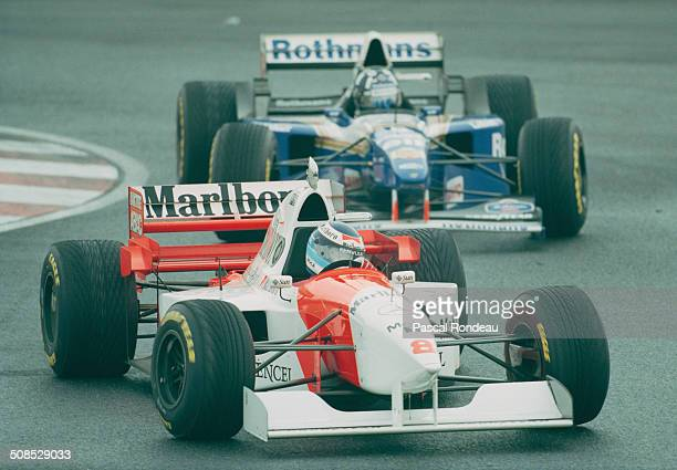 Mika Hakkinen of Finland drives the Marlboro McLaren Mercedes McLaren MP4/10B Mercedes FO110 V10 leads Damon Hill driving the Rothmans Williams...